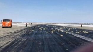 Avião russo deixa cair 200 barras de ouro na descolagem